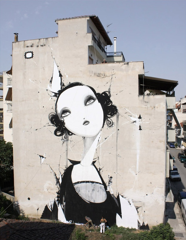 Lady on a wall.