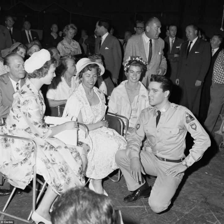 Elvis during a 1960 shoot of G.I. Blues as he meets with princesses Margrethe of Denmark (left), Astrid of Norway (center), and Margaretha of Sweden